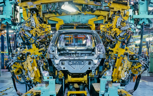 Car manufacturer producing car in assembly line.