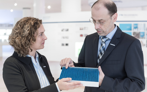 Freudenberg Filtration Technologies employees discussing quality of produced cabin air filter